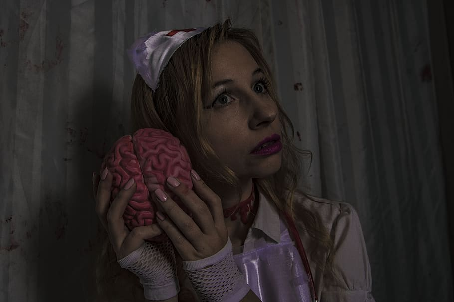 Crazy nurse mind-melding with a brain