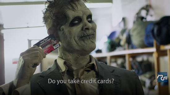 A Zombie holding a visa credit card with the text: Do you take credit cards?