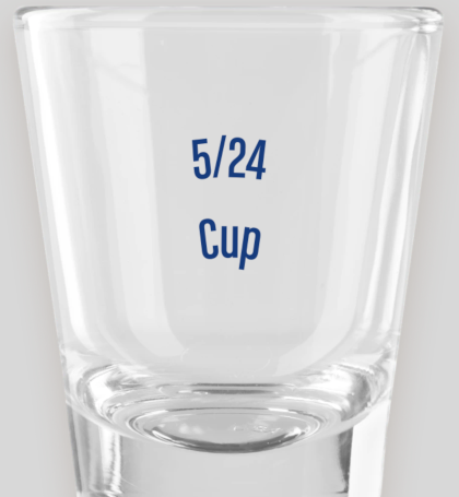 "A clear shot glass with the words ""5/24 Cup"" printed on the front."