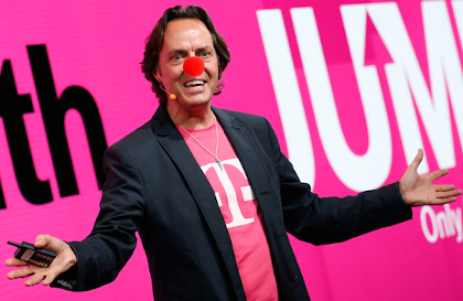 "An image of the T-Mobile CEO with a pink ""T"" tee shirt and a sport jacket wearing a clown nose."