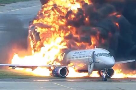 An aeroflot plane engulfed in flames.