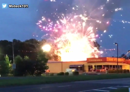 A fireworks store on fire.