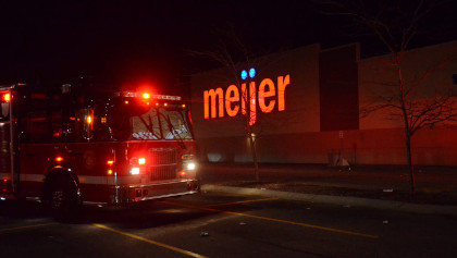 A fire truck in front of a Meijer store.
