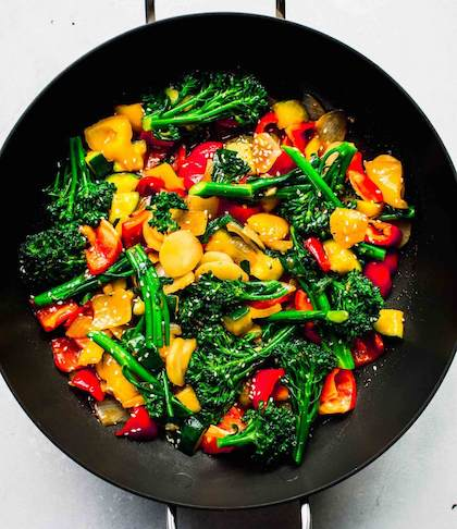 A prepared stir-fry of vegetables in a wok.