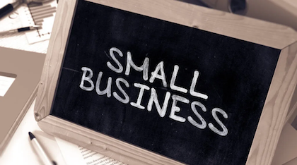 """A framed blackboard displaying the words """"Small Business""""."""
